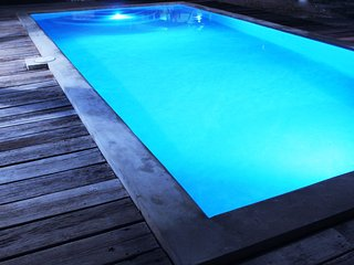 The pool at night with multi-colored lights to set the perfect mood.