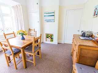 Dining room with bay window. There are 8 dining chairs in the bungalow
