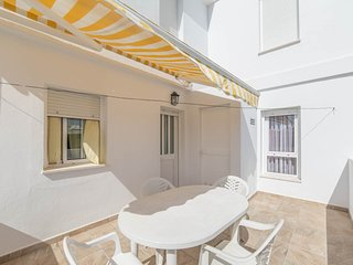 Terraza privada con toldo