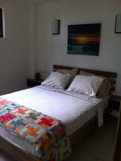 Bedroom 2 with queen bed with luxury Egyptian cotton sheets - garden and ocean views