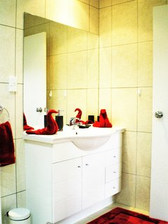 Full size bathroom with bath and shower. Luxury linen and cosmetics supplied