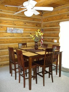 This is the dining room sits eight sliding doors to outside patio with table and chairs games galore