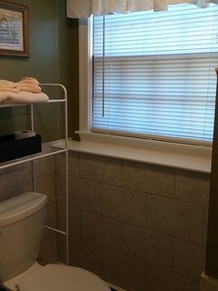 Bathroom 2 located downstairs.  Fully renovated with a stand up shower.