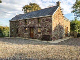 BWTHYN TRECOED, family friendly, country holiday cottage, with a garden in St
