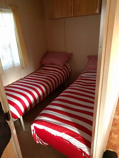 Single room, 2 beds. 1 wardrobe and overhead storage. Quilts and pillows. Please bring own covers.