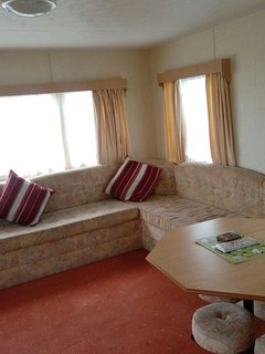 Lounge. Large seating area with fire place and dining table. comfortable and spacious.