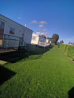 Front outside area. Grassed area, suitable for dog walking and children. Very safe.
