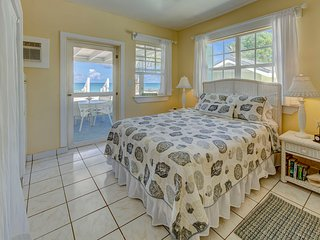Ocean side bedroom with access to your private veranda and beach.
