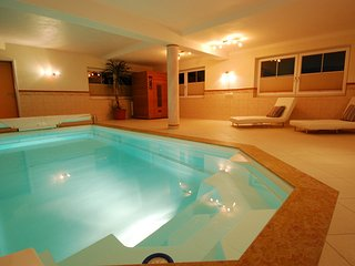 Private indoor pool and IR sauna.