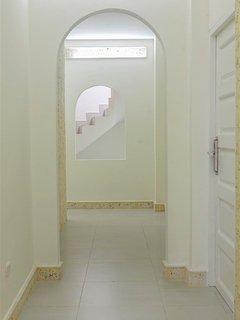 Interior hallway. Looks like an Escher drawing