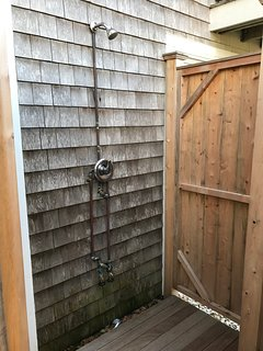 Enclosed outdoor shower with hot water and changing area.