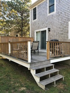 Back deck provides privacy and seating for  6-8. Gas grille.