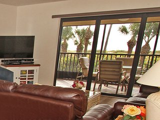 Living room doors open to lanai/porch to create an open space