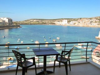 Sun-filled 2-bedroom apartment on St. Paul's Bay featuring furnished terraces with stunning views!, San Pawl il-Baħar (St. Paul's Bay)