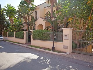Front of villa with street parking and secure garaging for 2 cars.