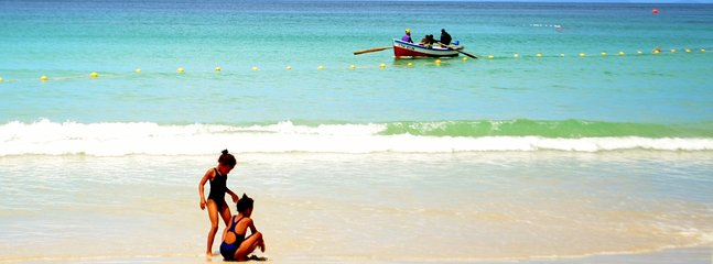 Fish Hoek beach with its white sands and crystal clear waters