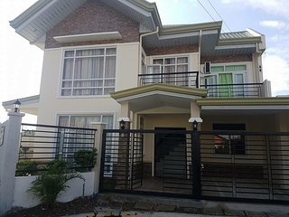 Fully furnished 4br brand new house in a secure subdivision with wifi & cable tv