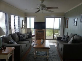 Living room with 2 walls of ocean views and new sofa/loveseat.