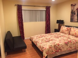 Master room suite with queen size bed and full size futon