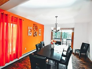 Gorgeous Dining Room With Deck Access