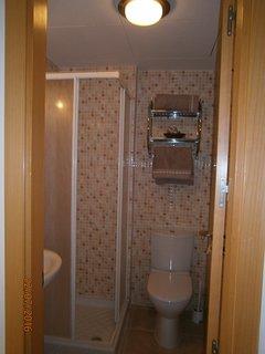 2nd Bathroom cubical shower, toilet & sink.