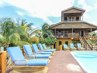 Unique waterfront villa w/ a private balcony & pool deck - walk to the beach!