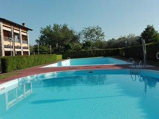 Bilocale giardino privato vista piscina