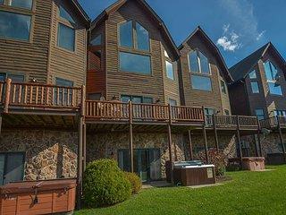 Enjoy lake & ski slope views and a prime location!
