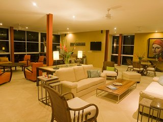Sit back in the large open concept seating area of the Casa Fantastica.