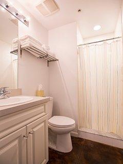 Full bathroom with walk-in shower.