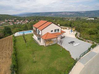 This spacious holiday home is situated in the small village Zmijavci, near the t
