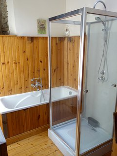 Bathroom - with bath, shower, sink and toilet. There is also a second bathroom with shower and WC.