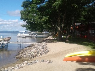 Log Cabin Rentals with fire places. 330' of lake front. Sandy beach. BEAUTIFUL, Houghton Lake