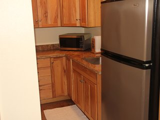 Kitchenette with full fridge, microwave, and hot plate