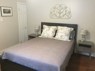 Master Bedroom with exit to back yard. Queen size bed.