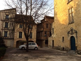 One of the many quiet squares in old Bergerac with the house on the corner