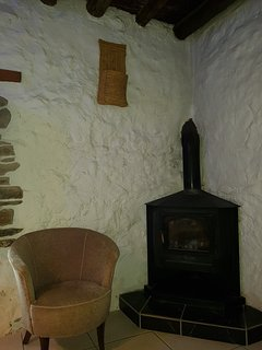 Alternative picture of small snug / cosy sitting room, showing wood burning stove.