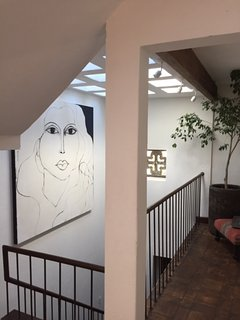 View toward skylights above stairs from ground floor to second floor.
