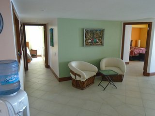 Sitting area in living space. Entrance to both king master bedrooms in picture.