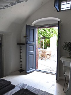 House of the singing birds view to the garden from inside