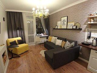Yellow studio apartment in center