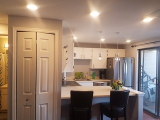 Updated kitchen with natural light flooding in from private covered deck