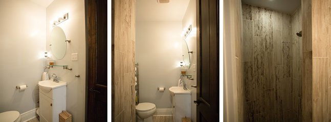 The clean and new bathroom boasts a huge walk-in shower - big enough for two!