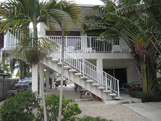 Spacious 4 Bedroom home on canal with Pool access at a private beach club.