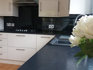 Kitchen with oven, hob, microwave, fridge freezer, dishwasher.