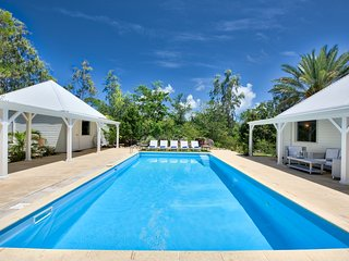 GREYSTONE...beautiful French Caribbean-style villa surrounded by lush tropical g