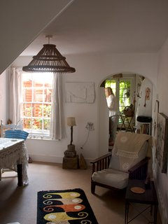 Main lounge room with dining table and view through to kitchen and garden