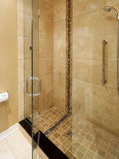 Deluxe large glassed-in shower in 2nd bath.