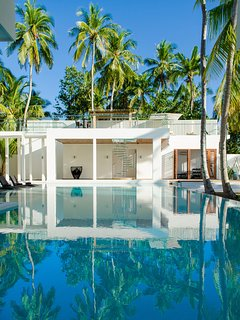 The Amilla Villa Estate - Contemporary beachfront luxe