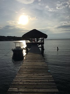 dock at sunset with our boat (you can rent our boat and captain)